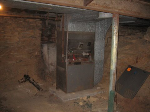 50 Basement under auditorium - cleaned out!  The furnace is being replaced.JPG - 33881 Bytes