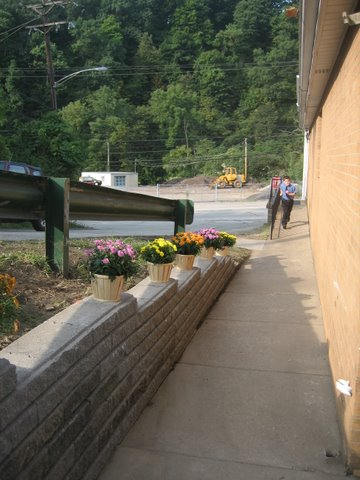 58 New retaining wall on the side of the church.JPG - 50451 Bytes